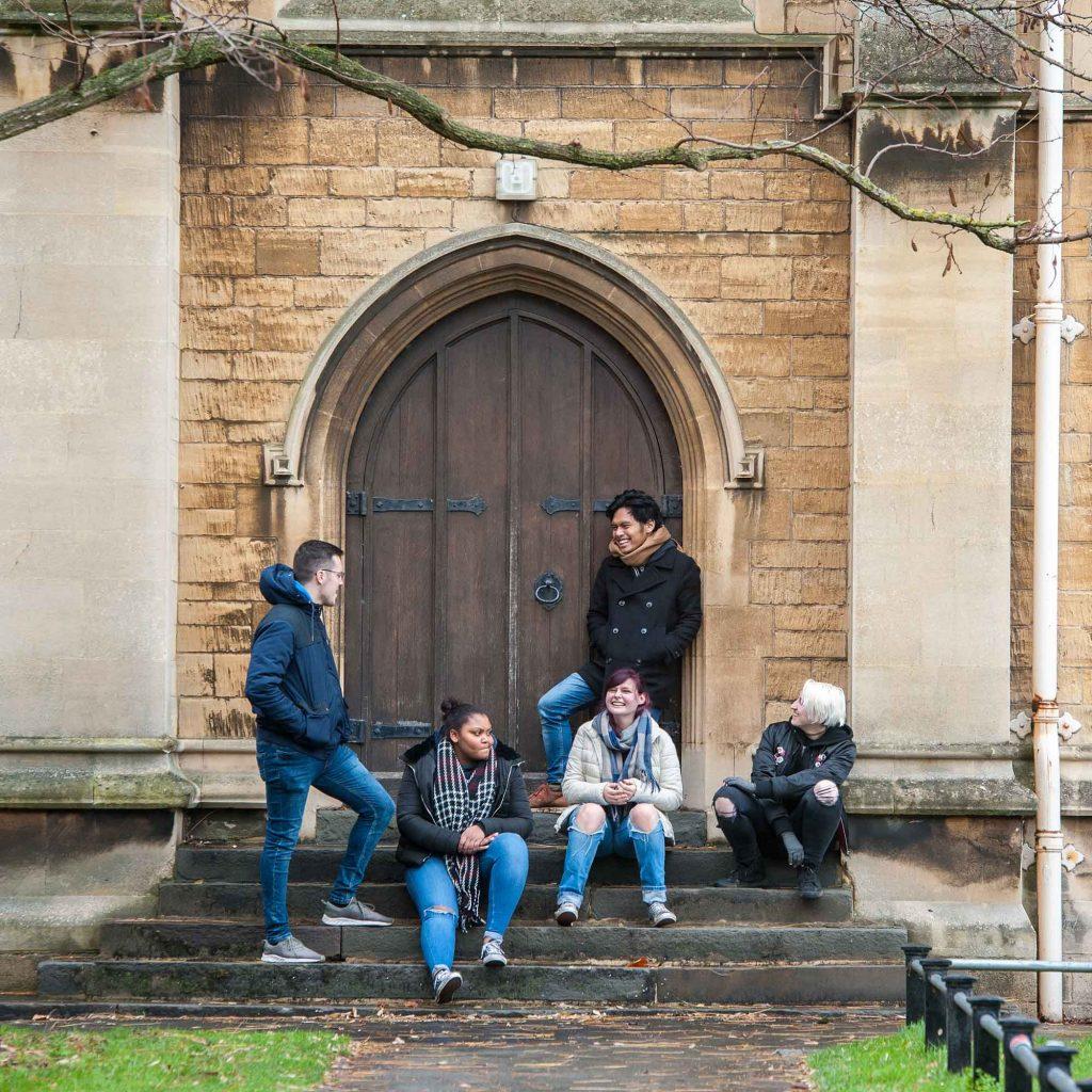 Students around dorrway at FCH campus