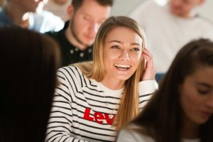 Smiling student in a lecture