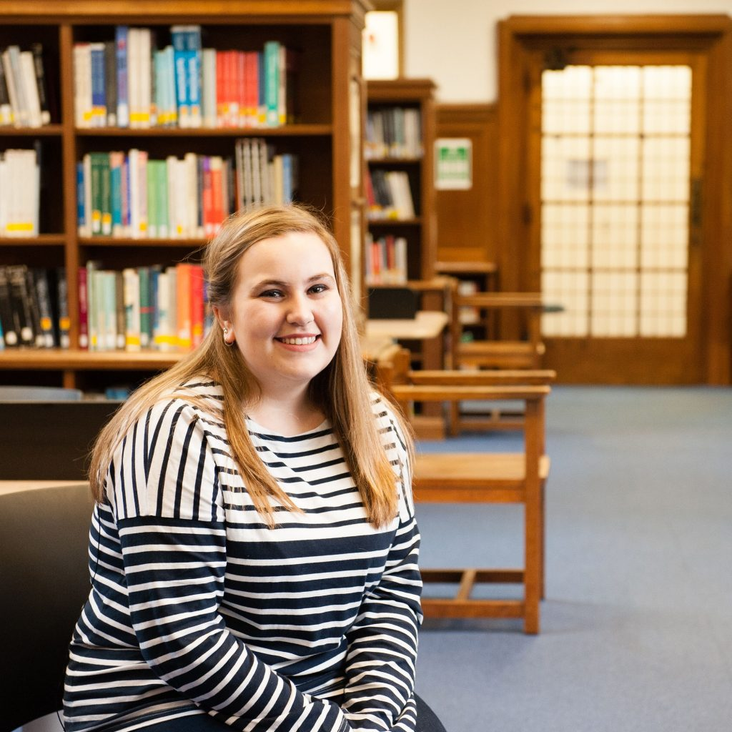 Student on History and Religious Studies course sitting in library at Francis Close Hall campus