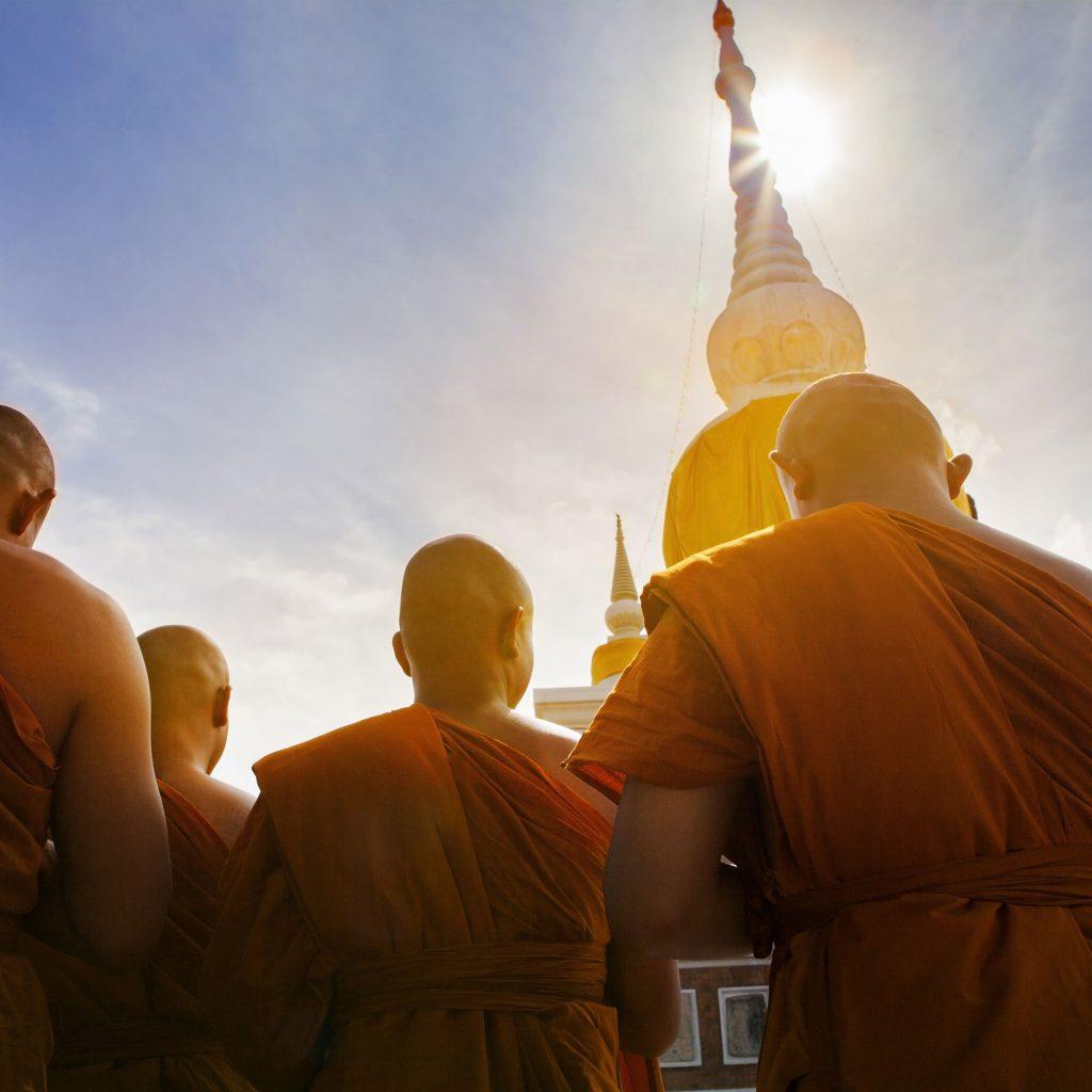 Buddist monks outside religious temple
