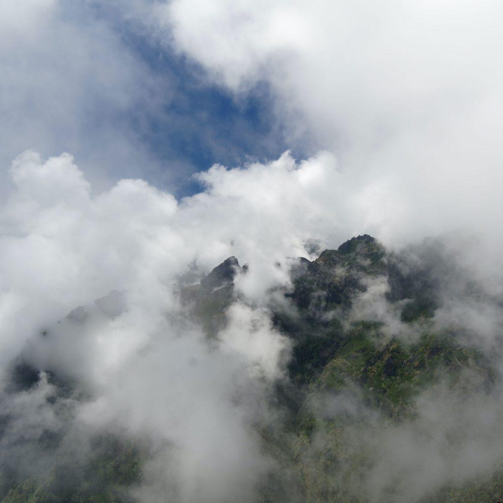 Mountain top through clouds