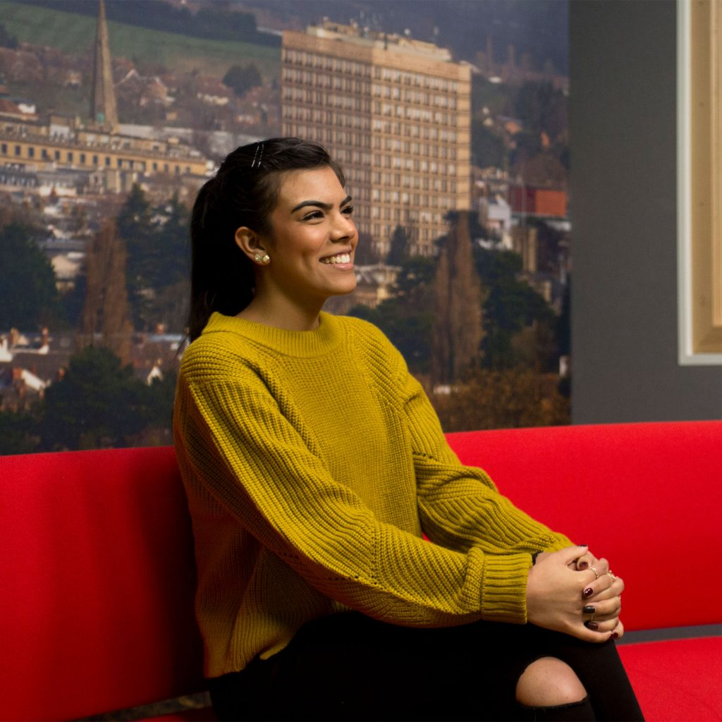 Student (Jade Padam) on Journalism course sitting on the sofa in the media studio at Park campus