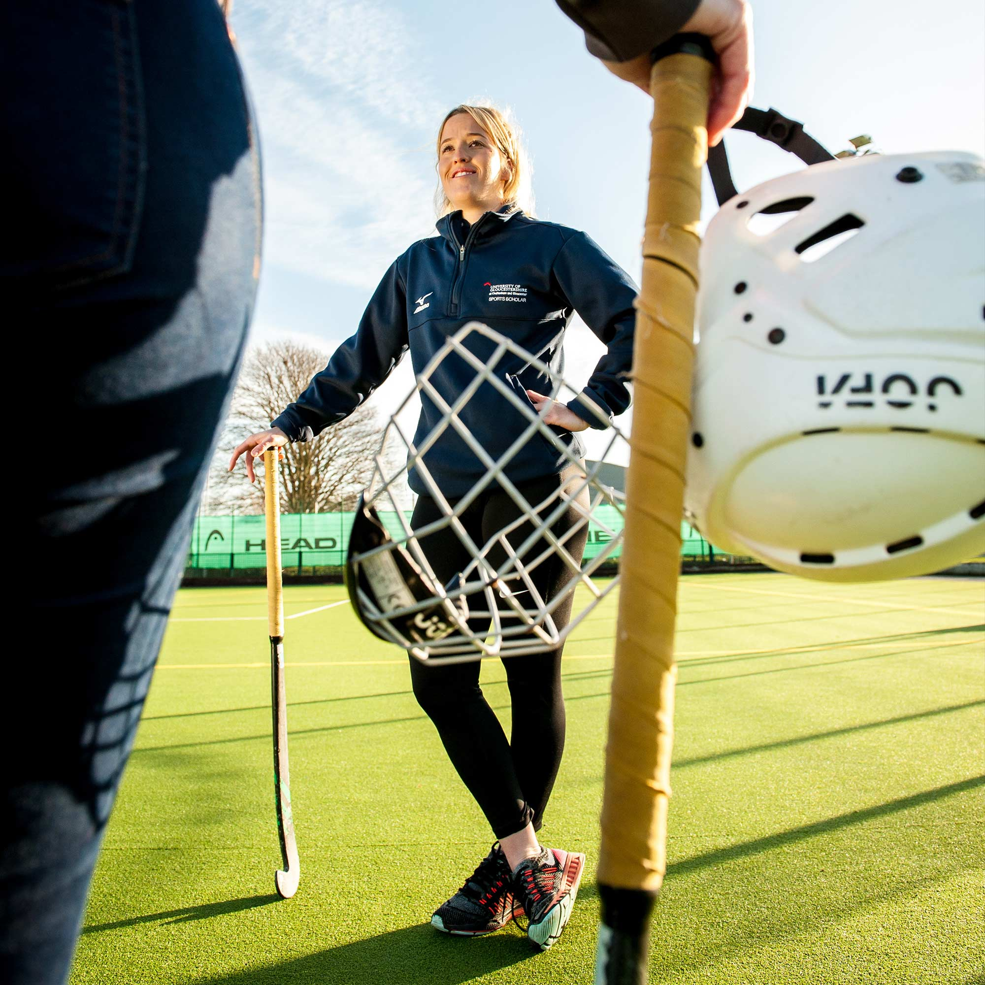 Female hockey player with her equipment