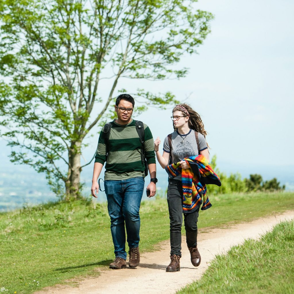 Two students walking in the countryside