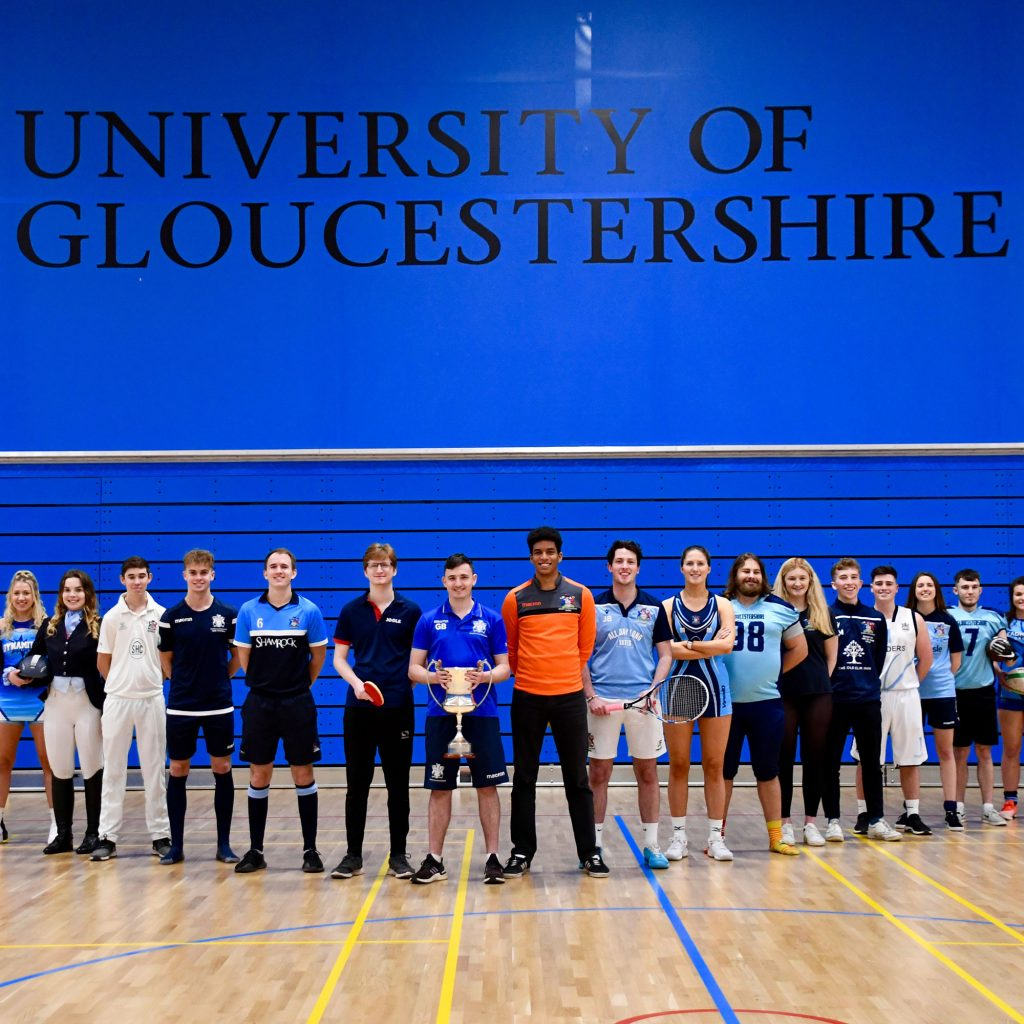 Aports team members lined up in University of Gloucestershire sports hall