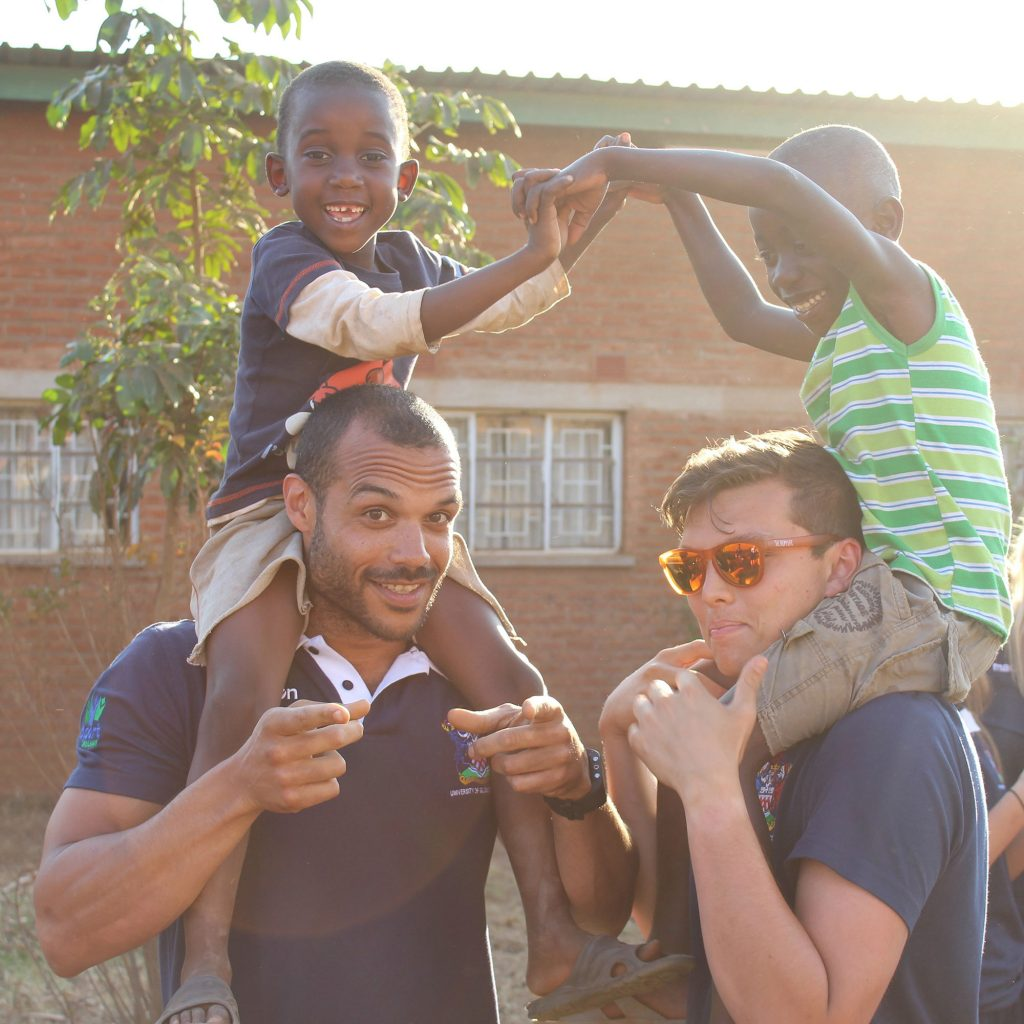 Sports students playing with local children in Malawi