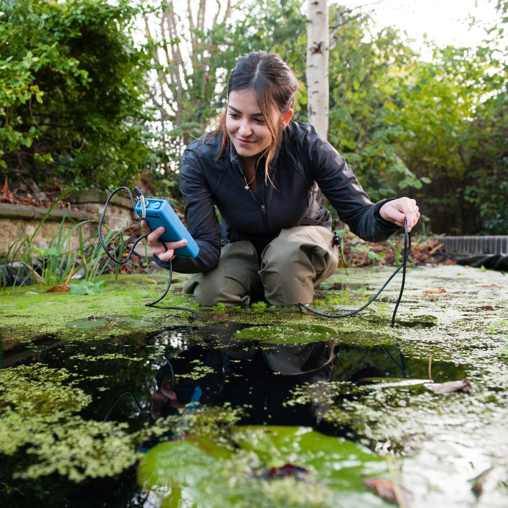 Student in a pond doing research