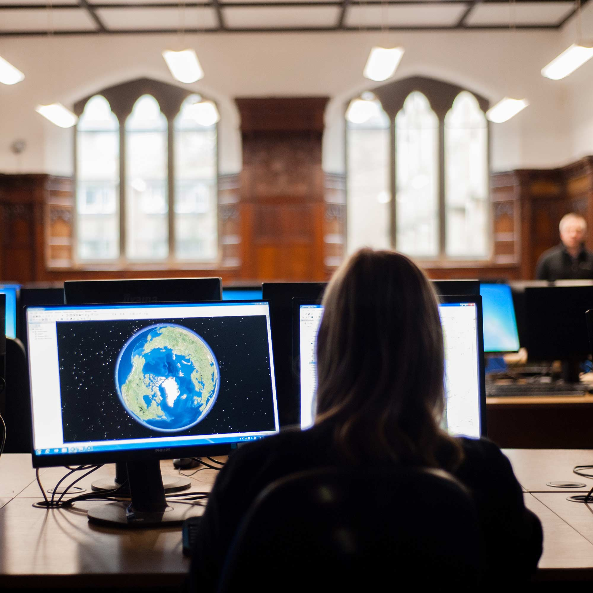 Student using a computer looking at google earth