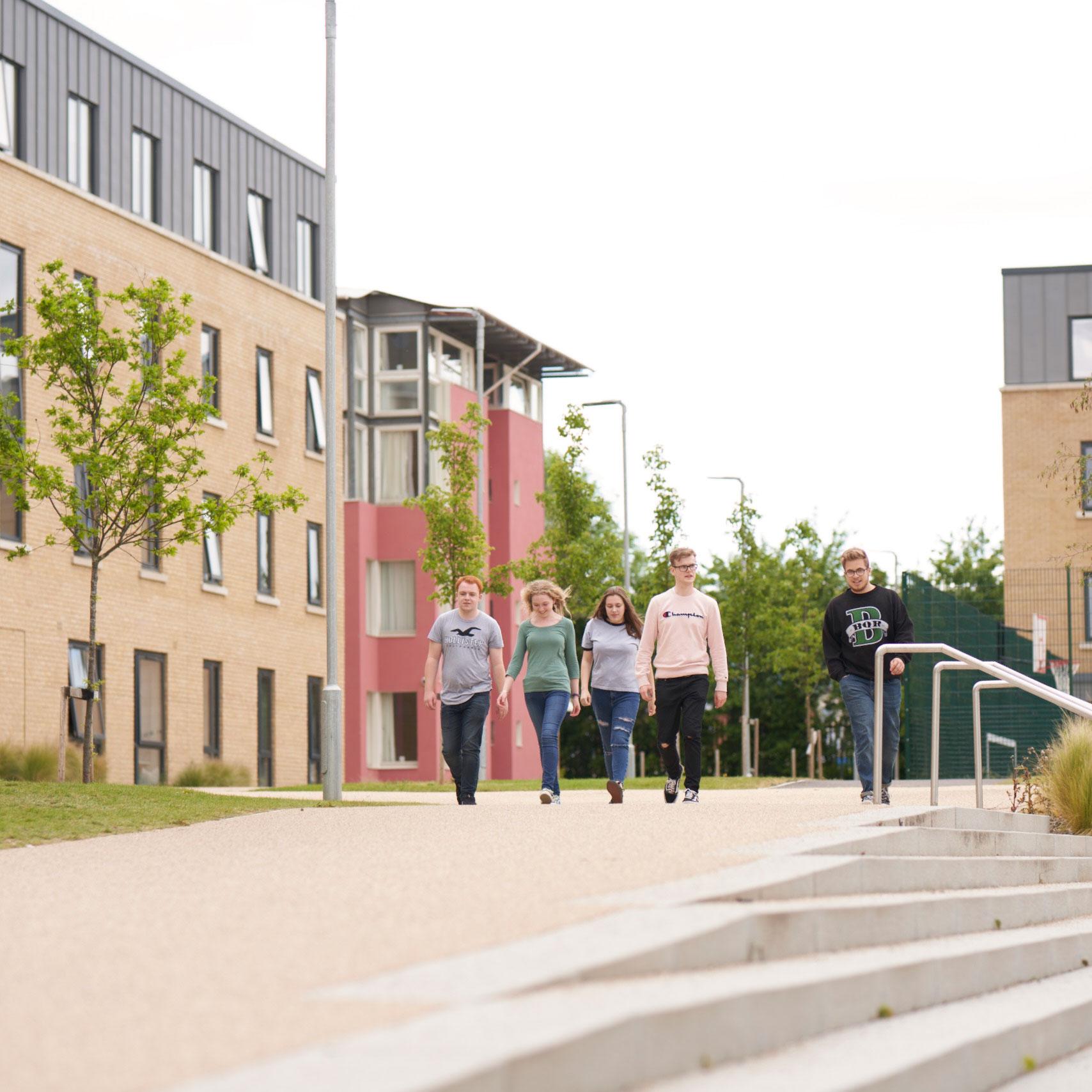 Students walking outside at Pittville Student Village, Cheltenham.