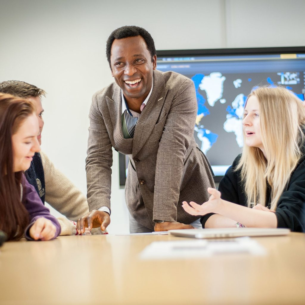 Lecturer laughing during a discussion with students