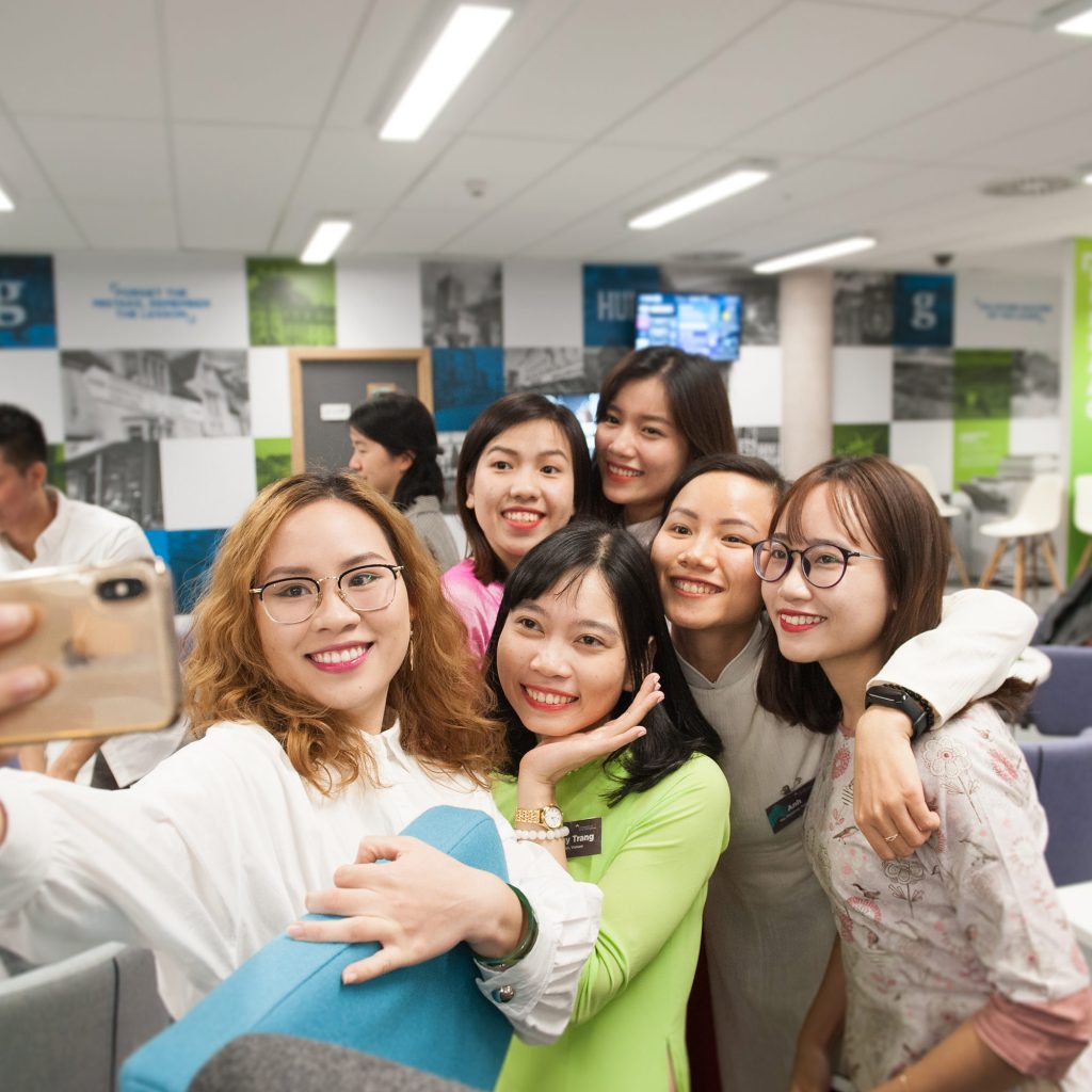 International students taking a group selfie