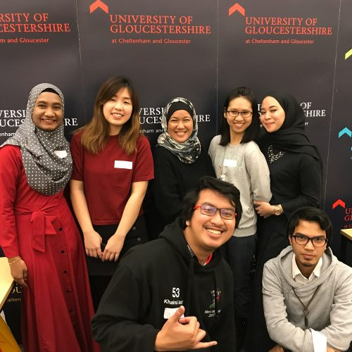 International team member with Malaysian students