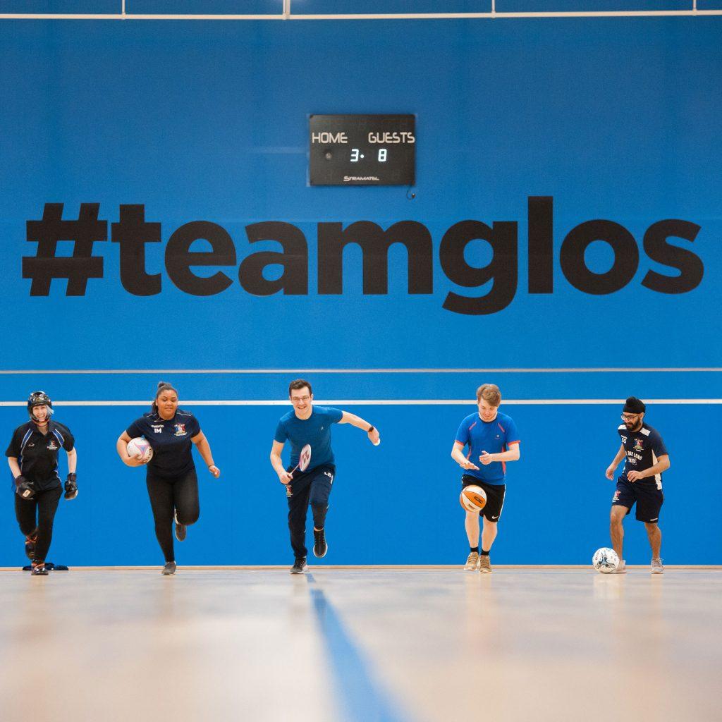 Sports teams members running towards camera