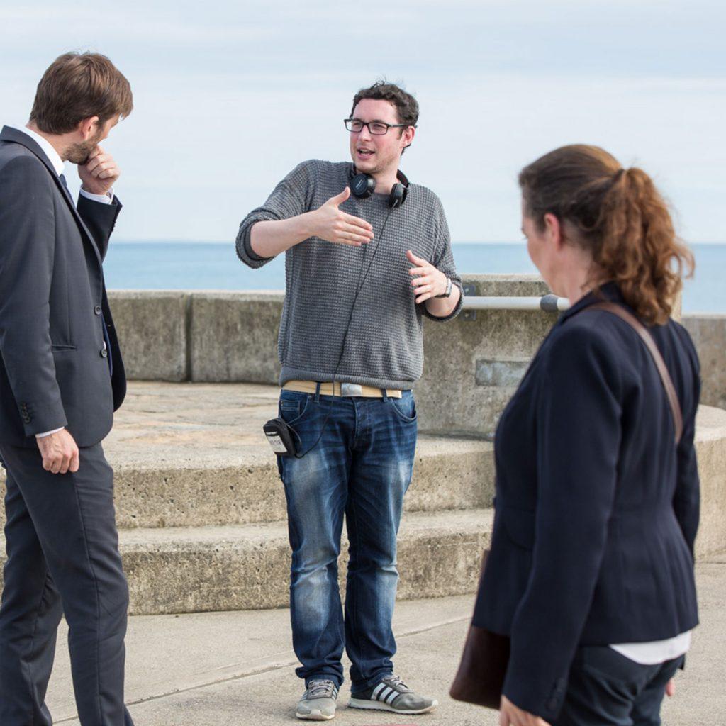 Student speaking with actors