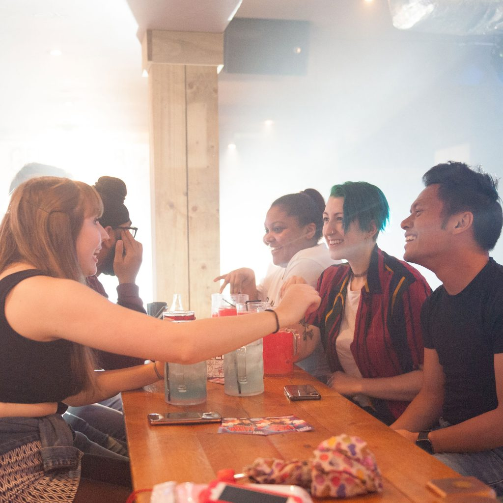 Students chatting over a drink