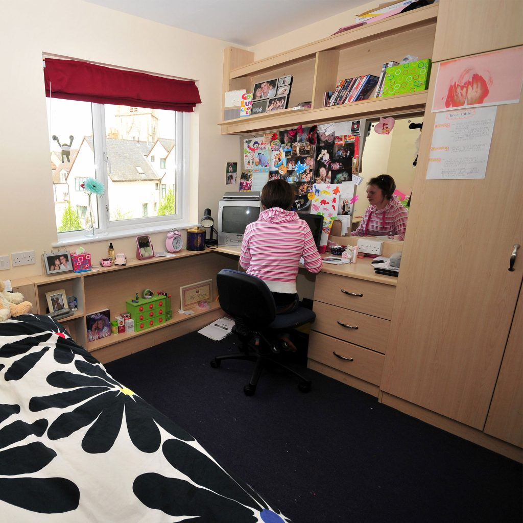 Student sat at desk with laptop in Upper Quay halls of residence