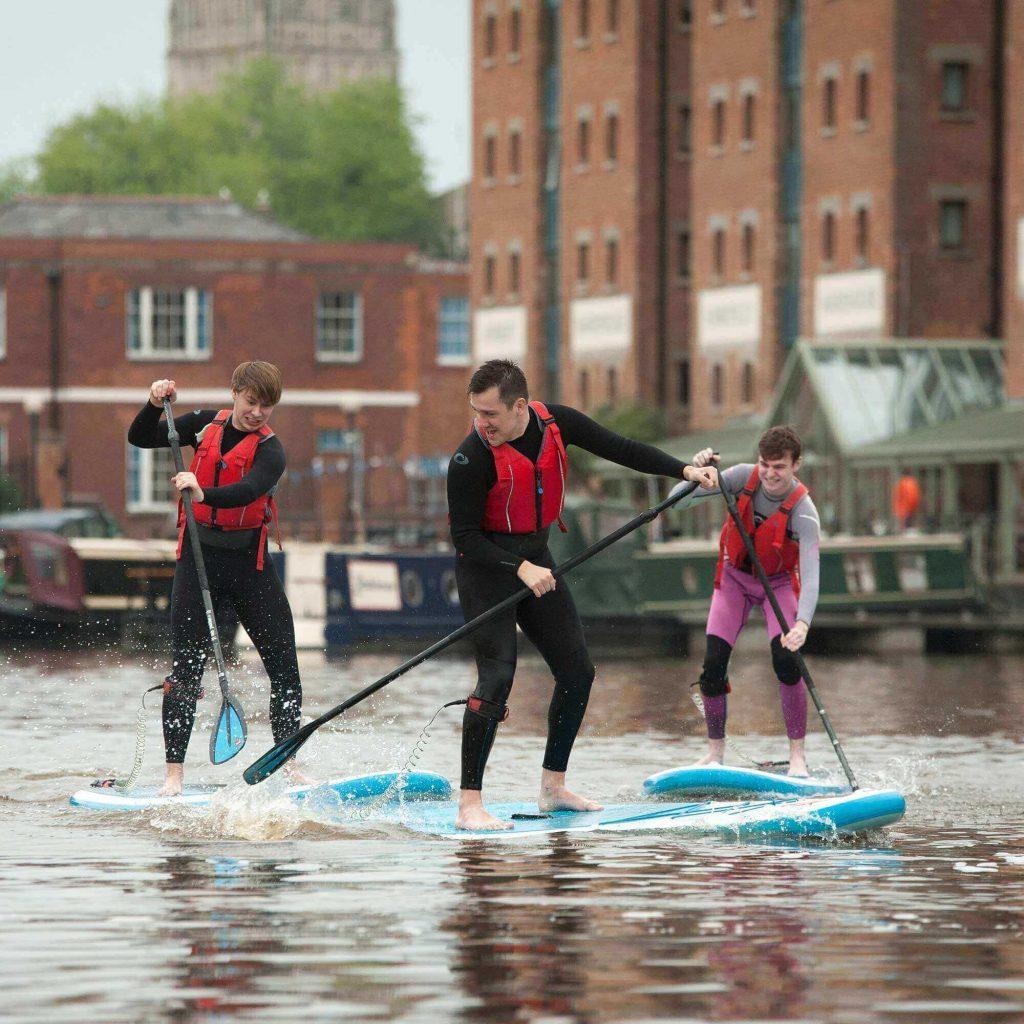 Students paddleboarding