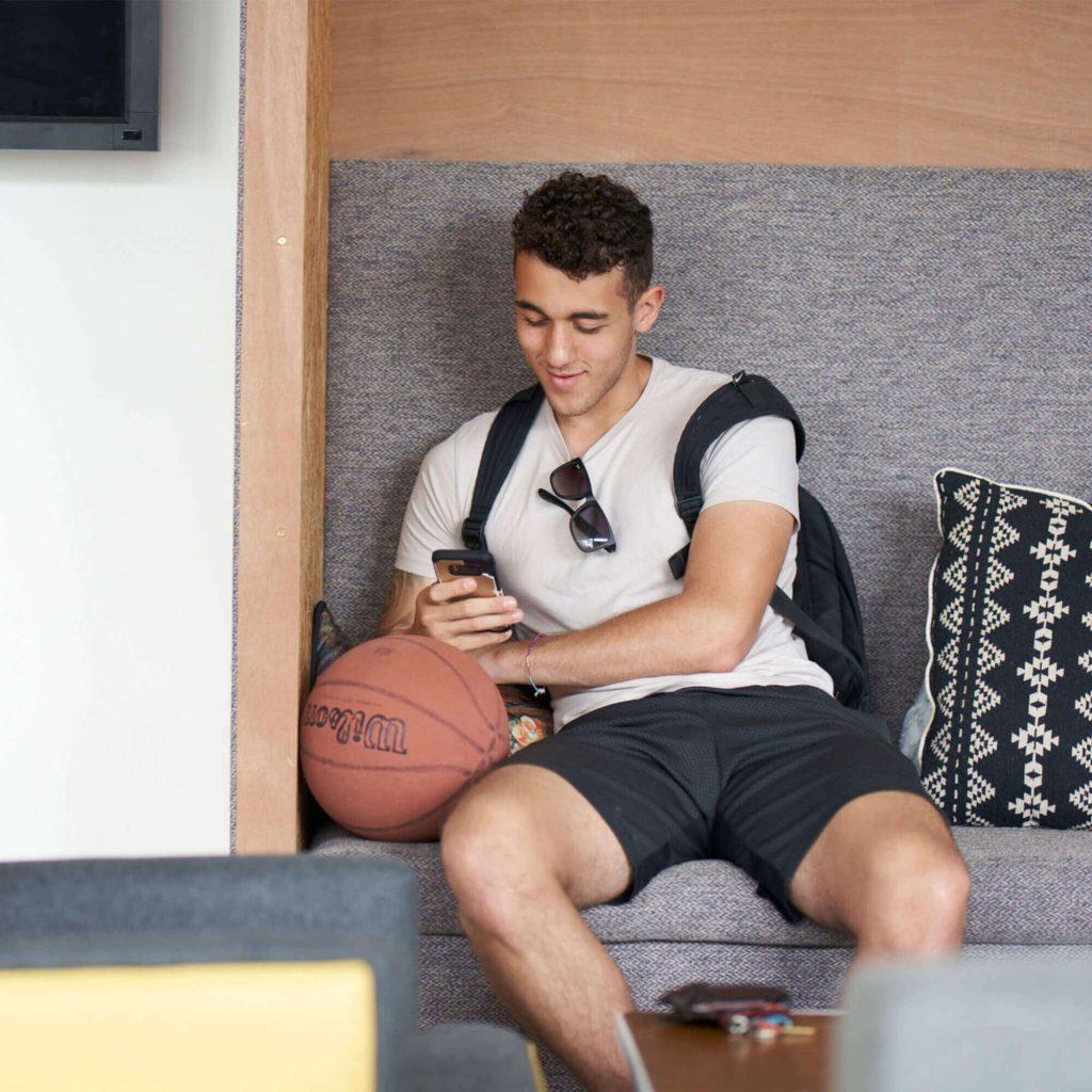 Student sat texting